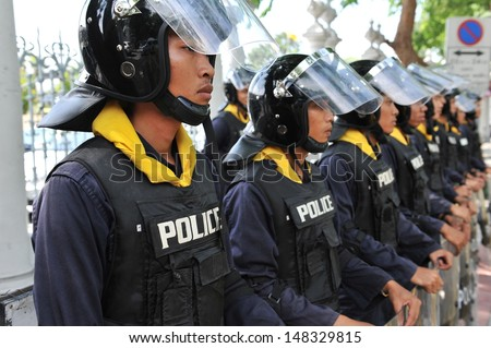 BANGKOK - AUG 1: Police on standby at Thai Parliament as the government invokes martial law amid threats to national security and planned anti-government rallies on Aug 1, 2013 in Bangkok, Thailand. - stock photo