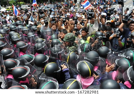 BANGKOK - AUG 7: Protesters confront police at a barricade near parliament during an anti-amnesty bill rally on Aug 7, 2013 in Bangkok, Thailand. About 3,000 protesters joined the rally. - stock photo