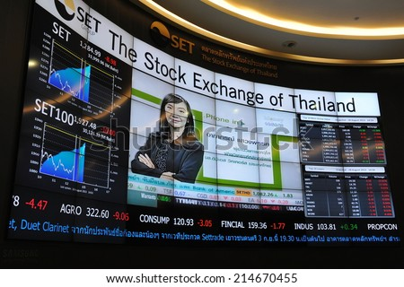BANGKOK - AUG 28: View of an electronic stock board of the Stock Exchange of Thailand (SET) on Aug 28, 2013 in Bangkok, Thailand. The SET has slumped 21% in recent weeks since this year's high in May. - stock photo