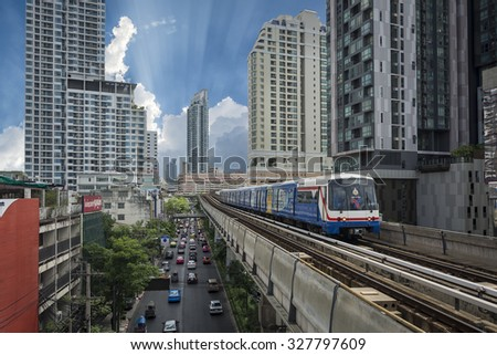 BANGKOK - August12: A BTS Skytrain in the city on August12, 2015 in Bangkok, Thailand. Each train of the mass transport rail network can carry over 1,000 passengers. - stock photo