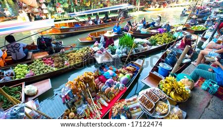 Bangkok August 2008. Busy sunday morning at Damnoen Saduak floating market, Bangkok Thailand of locals selling fresh produce, cooked food and souvenirs. - stock photo
