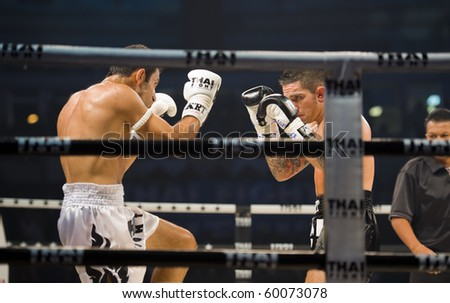 BANGKOK - AUGUST 29: English thaiboxing world champion Liam Harrison (R) in an international fight competition against Rafighdoust Behzan from Iran, on August 29, 2010 in Bangkok, Thailand. - stock photo