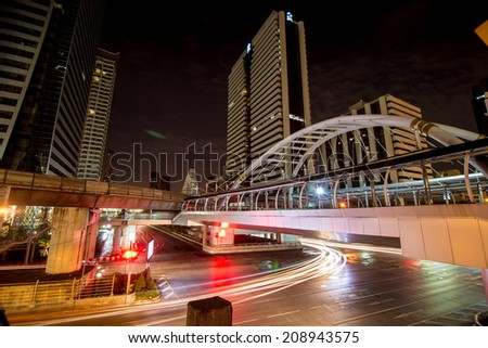 BANGKOK -August 2: high buildings and public sky walk for transit between Sky Transit and Bus Rapid Transit Systems at Sathorn-Narathiwas junction on August 2, 2014 in Bangkok, Thailand.