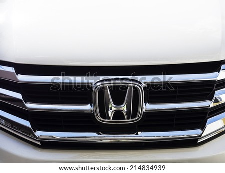 BANGKOK - AUGUST 23, 2014: Logo of Honda car in use on Bangkok, Thailand. Honda is a Japanese public multinational corporation and manufacturer of automobiles.