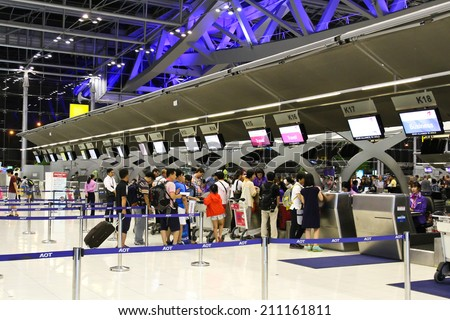 BANGKOK - AUGUST 15 : People waiting in check-in line K terminal of the Bangkok airport on August 15, 2014. Suvarnabhumi airport is world's 4th largest single-building airport terminal.