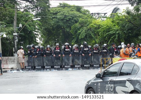 BANGKOK-AUGUST 7:  Riot police officers protecting the Parliament tightly due to the political unrest on August  7, 2013 in Bangkok Thailand.  - stock photo