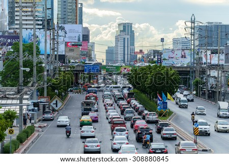 Bangkok - August 21, 2015: Traffic moves slowly along a busy road on August 21, 2015 in Bangkok, Thailand. Annually an estimated 150,000 new cars join the already heavily congested streets of Bangkok. - stock photo