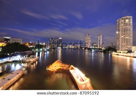 Bangkok City and Chao Phraya river at night - stock photo