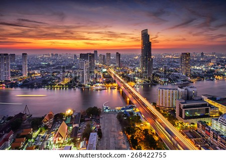 Bangkok city at sunset (Taksin Bridge) - stock photo