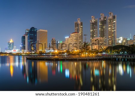 Bangkok city downtown at night with reflection of skyline, Bangkok,Thailand - stock photo