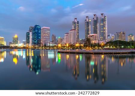 Bangkok city downtown twilight with reflection of skyline,Benjakitti Park,Bangkok,Thailand - stock photo