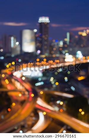 Bangkok city highway intersection, abstract blur bokeh city lights during twilight - stock photo