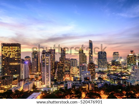 Bangkok city night light view point . Panoramic and perspective view light blue background of glass high rise building skyscraper commercial of future. Business concept of success industry tech .