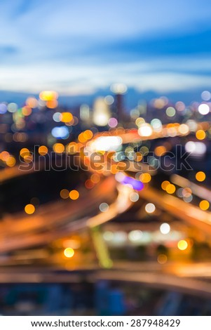 Bangkok city road, abstract blur bokeh light during twilight - stock photo