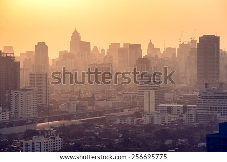 Bangkok City skyline with urban skyscrapers at sunset. - stock photo
