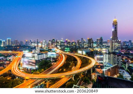Bangkok cityscape at night with express way - stock photo