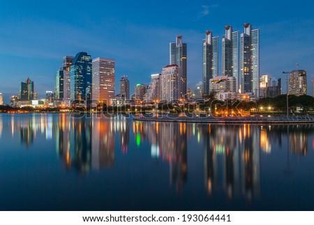 Bangkok cityscape at night with reflection - stock photo