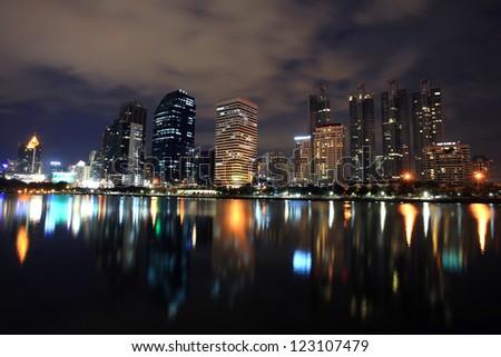 Bangkok cityscape at night with  skyline reflection,Thailand - stock photo