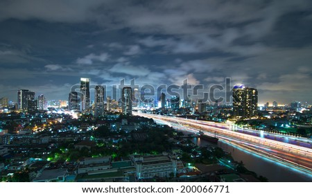 Bangkok cityscape Modern building river side at twilight time with boat traffic light,Thailand - stock photo