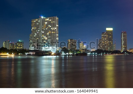 Bangkok cityscape Modern building river side on twilight time,Thailand