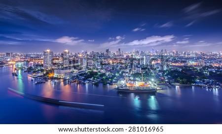 Bangkok Cityscape near river in twilight   - stock photo