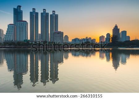 Bangkok cityscape sunrise with reflection of skyline ,Thailand - stock photo