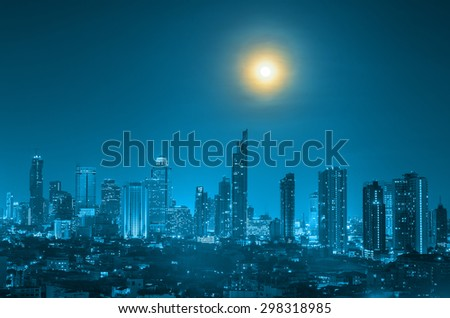Bangkok cityscape with full moon on the sky