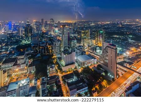 Bangkok cityscape with lightning at night - stock photo