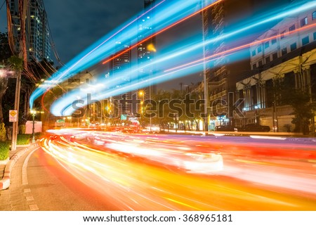 bangkok cityscapeof light trails with blurred colors on the street at night, thailand - stock photo