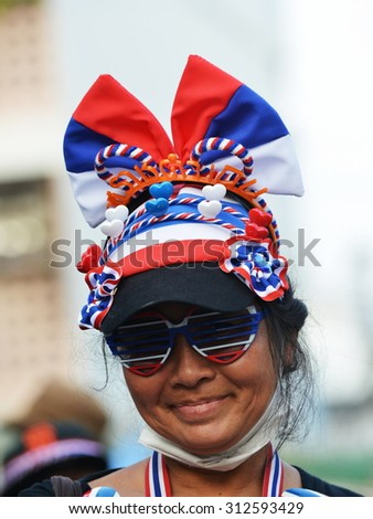 BANGKOK - DEC 21: A nationalist protester joins an anti government rally outside a police station on Dec 21, 2013 in Bangkok, Thailand. Protesters call for political reform. - stock photo