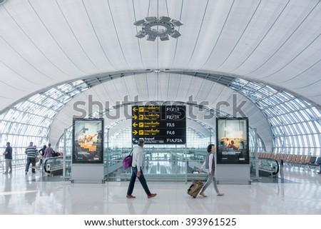 BANGKOK - DEC18: An unidentified travellers at Suvarnabhumi International Airport on December 18, 2015 in Bangkok, Thailand. The airport handles 45 million passengers annually - stock photo