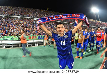 BANGKOK, DEC 10:Chanathip Sonkrasin(18) of Thailand after the competition 2014 AFF Suzuki Cup between Thailand and Philippines at Rajamangala stadium on December 10, 2014 in Bangkok, Thailand.  - stock photo