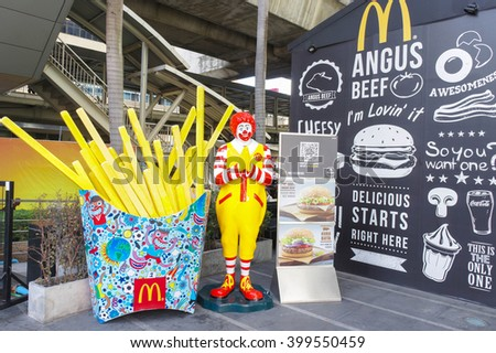 BANGKOK - DEC 30, 2015 : Photo of Ronald McDonald greeting visitor in front of a McDonald's popup store, Central World, Bangkok. McDonald's operates in 119 countries with 160 stores in Thailand - stock photo