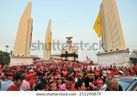 BANGKOK - DEC 10: Red Shirt protesters rally at Democracy Monument on Dec 10, 2010 in Bangkok, Thailand. Protesters gathered to show their opposition to the Democrat Party led government. - stock photo