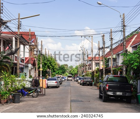 BANGKOK - DEC 29 : Thai life style is usually live in their home. Townhouses are populars living here for many people in main town. THAILAND DEC 29,2014 - stock photo
