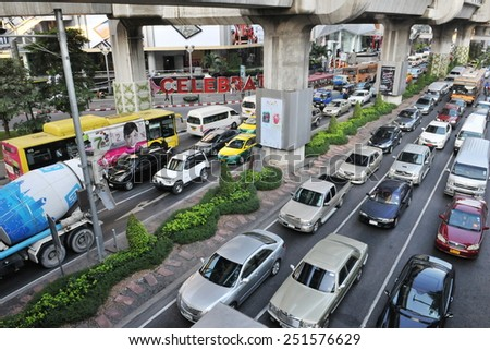 BANGKOK - DEC 22: Traffic moves slowly along a busy road in the business district on Dec 22, 2010 in Bangkok, Thailand. About 150,000 new cars join the congested roads of the Thai capital each year. - stock photo