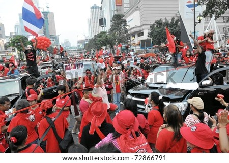 BANGKOK - DECEMBER 19: An estimated 10,000 anti-government red-shirts defy an emergency decree to protest at Ratchaprasong Junction December 19, 2010 in Bangkok, Thailand. - stock photo