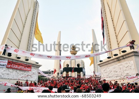 BANGKOK - DECEMBER 10: An estimated 5,000 Red Shirts at Democracy Monument protest against the government and current military drafted constitution on December 10, 2010 in Bangkok, Thailand. - stock photo