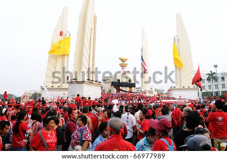 BANGKOK - DECEMBER 10: An estimated 5,000 Red Shirts demonstrate at Democracy Monument against the government and current military backed constitution on December 10, 2010 in Bangkok. - stock photo