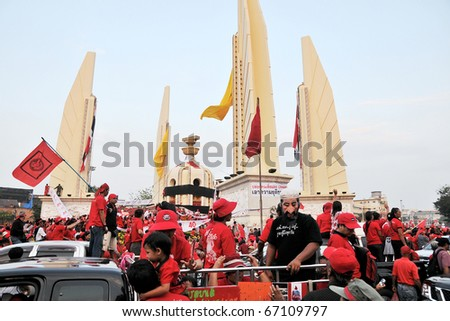 BANGKOK - DECEMBER 10: An estimated 5,000 Red Shirts gather at Democracy Monument to protest against the government and current military drafted constitution on December 10, 2010 in Bangkok, Thailand. - stock photo