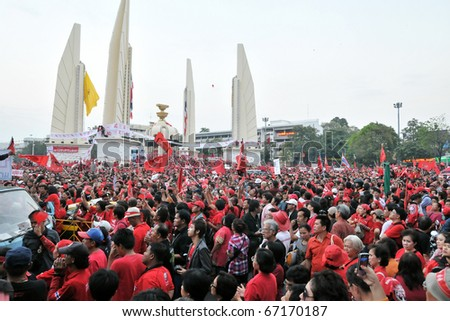 BANGKOK - DECEMBER 10: An estimated 5,000 Red Shirts gather at Democracy Monument to protest against the government and current military drafted constitution on December 10, 2010 in Bangkok. - stock photo