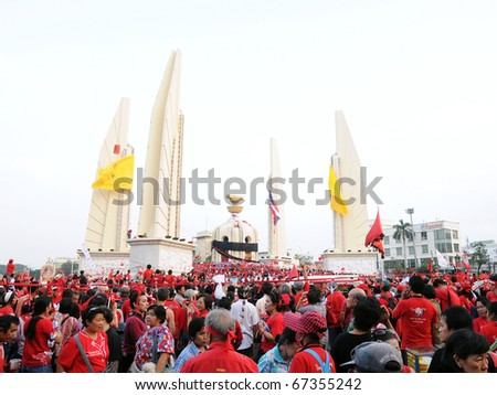BANGKOK - DECEMBER 10: An estimated 5,000 Red Shirts protest at Democracy Monument against the government and current military drafted constitution on December 10, 2010 in Bangkok, Thailand. - stock photo