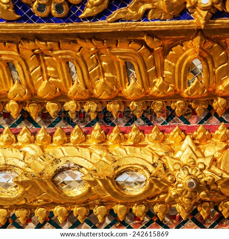 BANGKOK - DECEMBER 16: detail of the temple Wat Phra Kaew on December 16, 2014 in Bangkok. Wat Phra Kaew or Wat of the Emerald Buddha is regarded as the most sacred Buddhist temple in Thailand - stock photo
