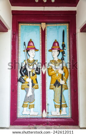 BANGKOK - DECEMBER 16: door detail at Wat Phra Kaew on December 16, 2014 in Bangkok. Wat Phra Kaew or Wat of the Emerald Buddha is regarded as the most sacred Buddhist temple in Thailand - stock photo