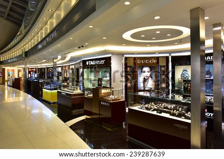 BANGKOK - DECEMBER 3 :Duty free shops at departure terminal of Suvarnabhumi Airport.  This is the world's third largest single-building airport terminal on December 3, 2014 in Bangkok ,Thailand. - stock photo