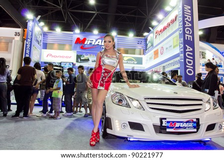 BANGKOK - DECEMBER 4: Female presenters model at the Mercedes Benz C 250 CGI Coupe car on display at the 28th Thailand International Motor Expo on December 4, 2011 in Bangkok, Thailand.