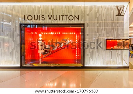 BANGKOK - DECEMBER 5: Front display of Louis Vuitton store on December 5, 13 in Bangkok, Thailand. Louis Vuitton founded in 1854, is the world's leading luxury brand with revenue 3.2 billion in 2012. - stock photo