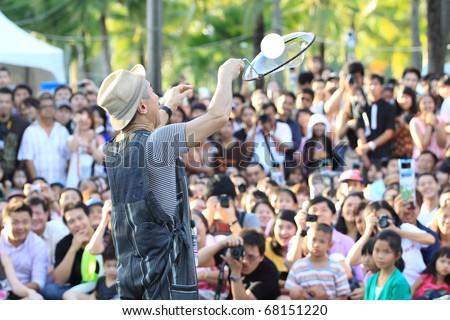 BANGKOK - DECEMBER 10: Fukidamaya bubble, an artistic mix of soap bubble show performs at Bangkok International Street Show in Lumpini Park on December 10, 2010 Thailand - stock photo