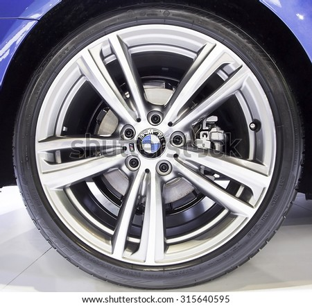 Bangkok - December 28 : logo of BMW on wheel - in display at Thailand international motor expo 2014 on December 28, 2014 in Bangkok Thailand