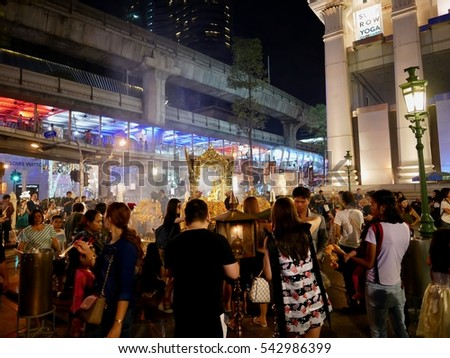 BANGKOK - DECEMBER 25: Many tourists come to worship the four-faced Brahma statue on December 25, 2016 at Erawan Shrine in Bangkok. The Erawan Shrine is a Hindu shrine in Bangkok, Thailand.